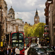 Busy street of London, England, the UK. Red buses, Big Ben — Stock Photo #35477283