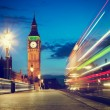 London, the UK. Red bus in motion and Big Ben at night — Stock Photo