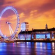 London, England the UK skyline in the evening, London Eye illuminated — Stock Photo