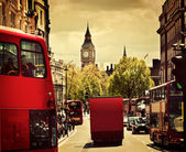 Busy street of London, England, the UK. Red buses, Big Ben — Stock Photo