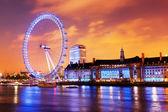 London, England the UK skyline in the evening, London Eye illuminated — Stock Photo
