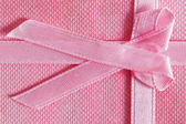 Pink gift box with tied ribbon — Stock Photo