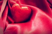 Red heart in satin cloth. Love, background — Stock Photo