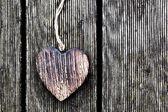 Wooden vintage heart on grunge wood planks — Stock Photo