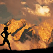 Woman running, jogging in the mountains — Stock Photo