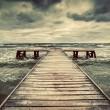 Wooden jetty during storm on the sea — Stock Photo #48613601