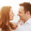 Young happy couple in love. Romantic moment on the beach in sunshine — Stock Photo