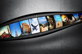 Film strip with colorful, vibrant photographs on grunge wall. Travel theme — ストック写真
