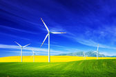 Wind turbines on spring field. — Stock Photo