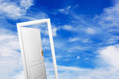 Open door on blue sunny sky. — Foto Stock