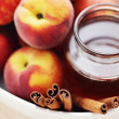 Peaches with honey and cinnamon - Stock Photo