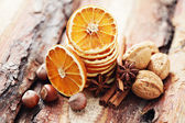 Dry oranges with walnut and cinnamon — Stock Photo