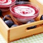 Yogurt with plums — Stock Photo #39703375