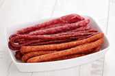 Long dry sausages — Stock Photo
