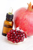 Pomegranate essential oil — Stock Photo