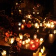 Candle flames illuminating on cemetery during All Saint - Stock Photo