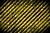 Grunge arka plan, sarı çizgili — Stok fotoğraf