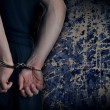 Men with handcuffs - Stock Photo