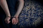Men with handcuffs — Stock Photo
