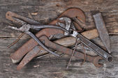 Old tools on a wooden background — Stock Photo