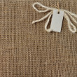 Stock Photo: Brown Fabric Burlap Texture for the background with label for text