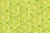 Abstract green background with citrus-fruit of lime slices. Close-up pattern — Stock Photo