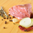 Fresh raw meat with spices, red chili pepper, onion and rosemary on the board — Stock Photo