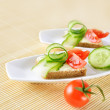 Canapes on plate. Close-up. — Stock Photo