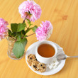 Breakfast still life. Cookies with cup of tea and flowers. Top view. — Stock Photo #29839933