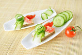 Beautiful canapes on plate — ストック写真