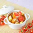 A bowl of healthy potato soup with carrot, tomatoes and meat — Stock Photo