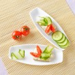 Canapes with butter and vegetables on plate. Top view — Stock Photo