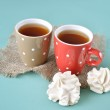 Two cups of tea with meringue cookies — Stock Photo #29843255