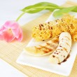 Closeup image of a delicious pancakes with banana and chocolate syrup on it. Beautiful tulip flower on the background. — Stock Photo #29843777