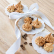 Vanilla meringue cookies on wooden background with copy space. Cakes with white ribbon and coffee. — Stock Photo #29844311