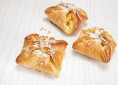 Puff pastry on the wooden white table — Stock Photo