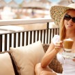 Attractive woman enjoying coffee on a vacation — Stock Photo