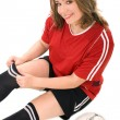 Young woman in soccer uniform - Stock Photo