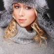 Attractive blond girl in fur hat — Stock Photo