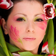 Closeup of woman face framed with tulips — Stock Photo