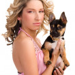 Young woman with a small dog - Stock Photo