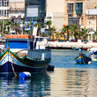 Maltese boats in a bay — Stock Photo #19269543