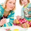 Stock Photo: Mother and daughter painting together