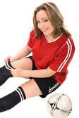 Jeune femme en uniforme de soccer — Photo