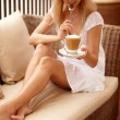 Attractive woman enjoying cup of coffee - Stok fotoraf