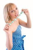 Girl in a blue polka dot dress — Stock Photo