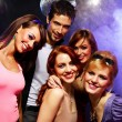 Happy friends on a party - Stock Photo