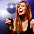 Happy beautiful girl with a drink in nightclub — Stock Photo #22514373