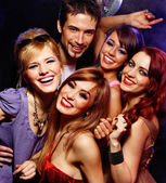 Happy vänner på en fest — Stockfoto