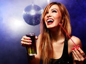 Happy beautiful girl with a drink in nightclub — Stock Photo